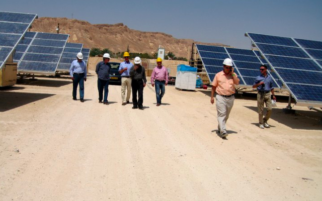 Yosef Abramowitz (in peach shirt) and his partners at Israel's first solar field in 2013 (photo credit: Courtesy Yosef Abramowitz)