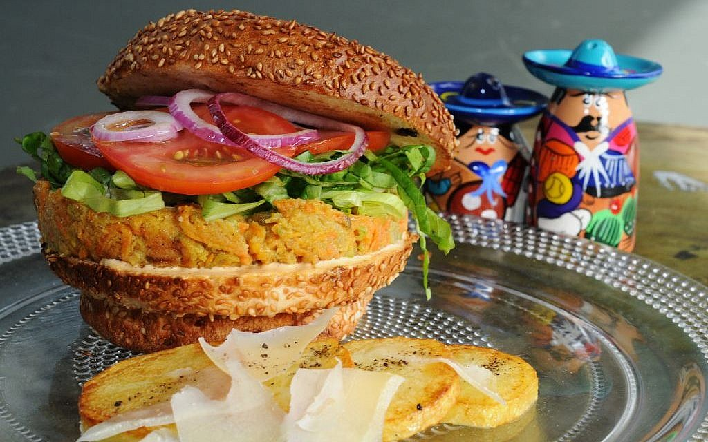 Take a bite out of Cafe Christopher's veggie burger, only in Jaffa. (photo credit: Courtesy Phyllis Glazer)