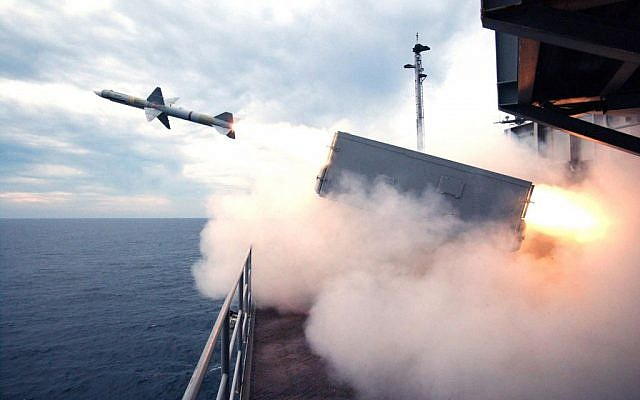 A NATO Sea Sparrow missile is launched during a live-fire self-defense missile exercise aboard the aircraft carrier USS Harry S Truman in 2004. (Photo credit:  Petty Officer 2nd class Jason P. Taylor/US Navy, Department of Defense).