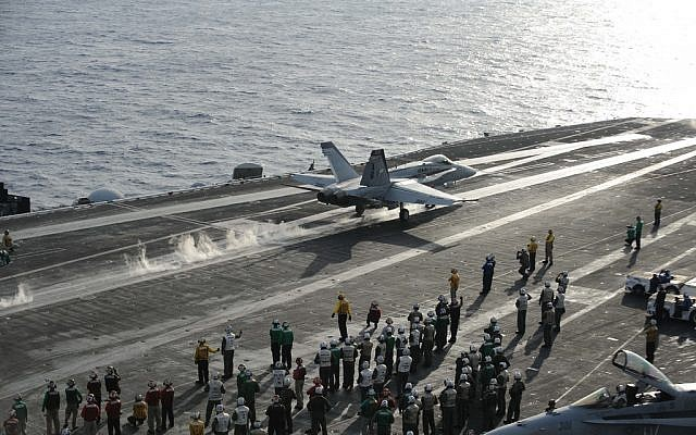 A fighter jet launches from the flight deck of the Nimitz-class aircraft carrier USS Dwight D. Eisenhower in the Mediterranean, December 2012 (photo credit: CC BY-NC-ND US Department of Defense, Flickr)