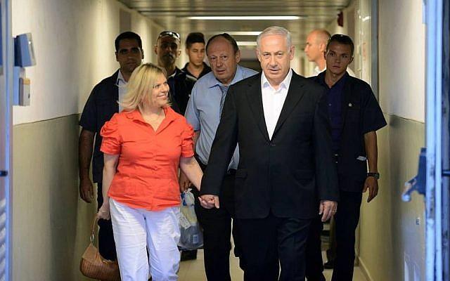 Benjamin Netanyahu (right) and his wife leave the Hadassah hospital, Sunday (photo credit: PMO/via Faceboook)
