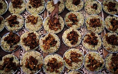 Illustrative photo of plates of food arranged for Iftar, the meal that breaks the day's fast during Ramadan, in Islamabad, Pakistan, last month (photo credit: AP/B.K. Bangash)