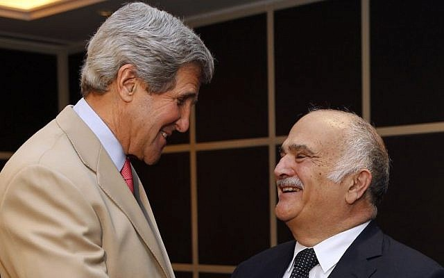 Prince Hassan bin Talal of Jordan, right, meets US Secretary of State John Kerry in Amman, Jordan, in May (photo credit: AP/Jim Young)