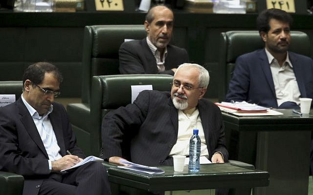 Iranian Foreign Minister Mohammad Javad Zarif, center, at an August 13 session in parliament (photo credit: AP/Ebrahim Noroozi)