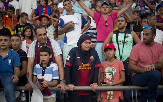 Israeli Jews and Arabs watch, together, as FC Barcelona plays in Bloomfield Stadium in Tel Aviv, Israel, Sunday, August 4, 2013. (photo credit: AP Photo/Ariel Schalit)