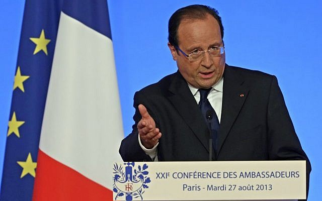 French President Francois Hollande delivers his speech during a conference with France's ambassadors, at the Elysee Palace, in Paris, Tuesday Aug. 27, 2013. (photo credit: AP/Kenzo Tribouillard)