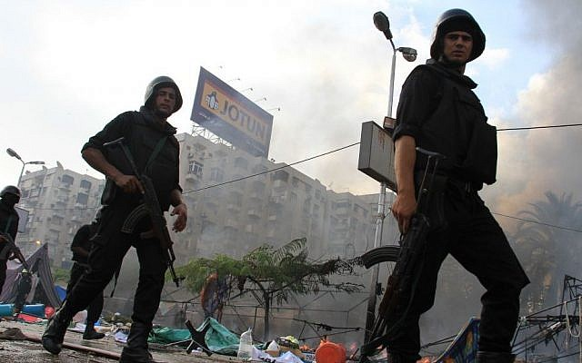 Egyptian security forces clear a sit-in by supporters of ousted Islamist President Mohammed Morsi in the eastern Nasr City district of Cairo, Egypt, on Wednesday, Aug. 14, 2013. (photo credit: AP Photo/Ahmed Gomaa)