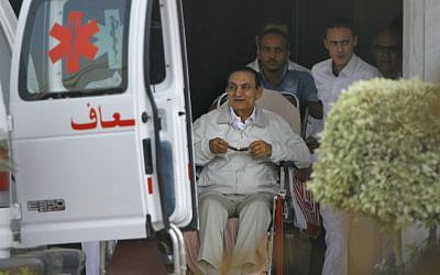 Former Egyptian President Hosni Mubarak, 85, is escorted by medical and security personnel into an ambulance to be taken by helicopter ambulance from to court, Cairo, Egypt, Sunday, Aug. 25, 2013. (photo credit:AP/Amr Nabil)