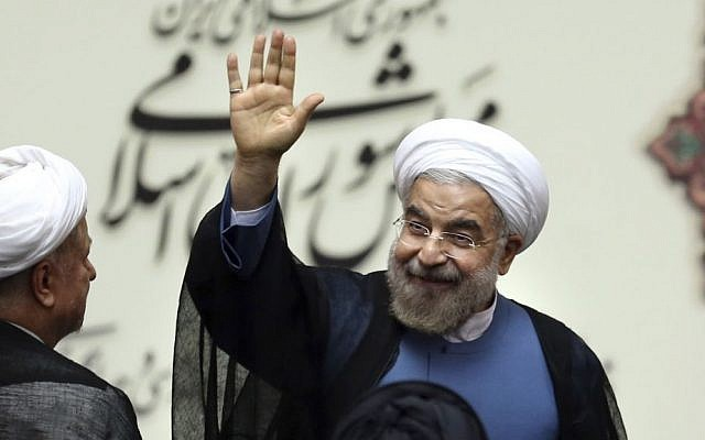 Iranian President Hassan Rouhani waves after his swearing-in ceremony at the parliament, in Tehran, August 4, 2013. (photo credit: AP/Ebrahim Noroozi)