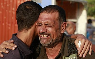 Relatives grieve for Mohammed Ali, 18, who was killed when a suicide bomber attacked a park in Baghdad, Iraq, on Saturday, August 24, 2013. (photo credit: AP/Hadi Mizban)