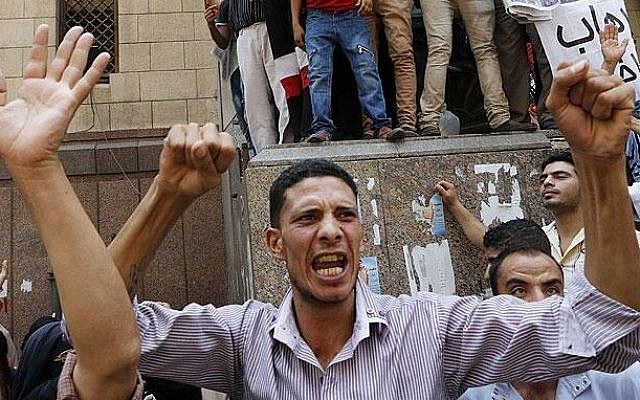 Supporters of ousted Egyptian president Mohammed Morsi take to the streets on Friday (photo credit: AJELive via Twitter)
