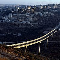 A view from the Israeli settlement of Har Gilo of Route 60, backdropped by the West Bank village of Beit Jala (Abir Sultan/Flash 90)
