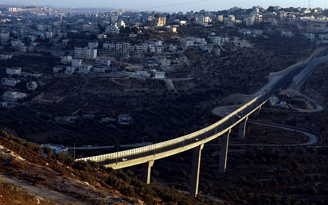 A view from the Israeli settlement of Har Gilo of Highway 60, backdropped by the West Bank village of Beit Jala (photo credit: Abir Sultan/Flash 90)