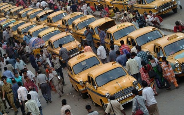 Taxis lined up outside the Calcutta main train station in India (Deborah Sinai/Flash90)