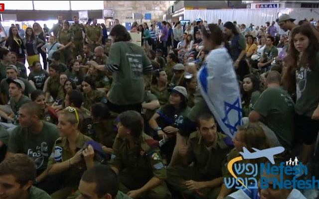A Nefesh B'Nefesh flight welcome ceremony in Ben Gurion airport, August 13, 2013. (screen capture: Nefesh B'Nefesh)