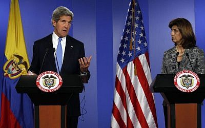 US Secretary of State John Kerry, left, speaks as Colombia's Foreign Minister Maria Angela Holguin looks on during a joint news conference in Bogota, Colombia, on Monday. (photo credit: AP/Fernando Vergara)