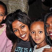 Maggie Meganenke Mengisto, second from right, and Zahava Mero, right, visit their young cousins, Damaka's daughters (photo credit: Michal Shmulovich/ToI)
