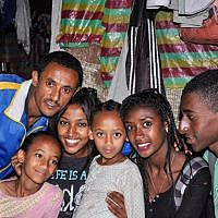 Damaka Mengisto, left, with his two young daughters and their three relatives (from left: Maggie, Zahava, and Buyota) who were visiting Ethiopia from Israel on a Jewish Agency-sponsored trip, Samai, last December (photo credit: Michal Shmulovich/ToI)