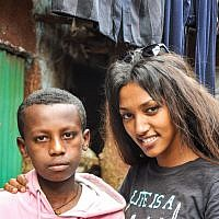 After she discovers she has a half-brother in Gondar, Maggie Mengisto meets him for the first time (photo credit: Michal Shmulovich/ToI)