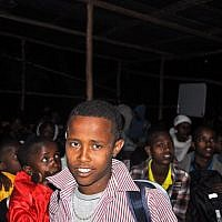 A young teenage boy waits with the group before boarding the bus to Addis Ababa (photo credit: Michal Shmulovich/ToI)