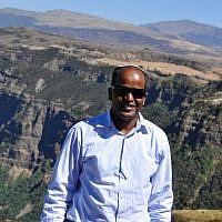 David Mihret with a view of the Simian mountains, which many Ethiopian-Jews crossed to get to Sudan, and then Israel, when fleeing war and famine in Ethiopia during the 1980s (photo credit: Michal Shmulovich/ToI)