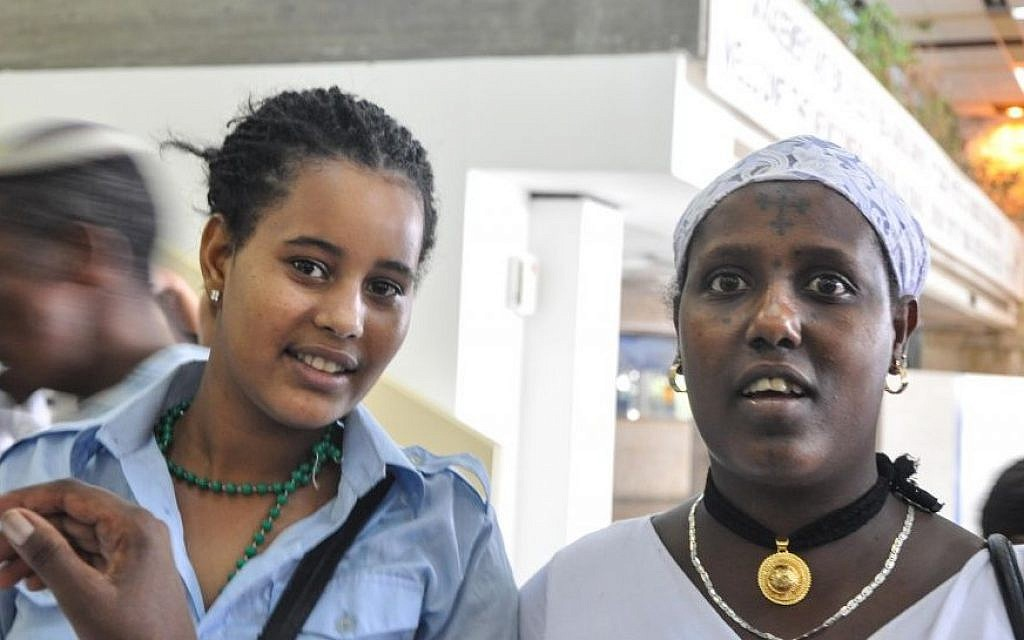 Moonmoone, left, and Sugaro wait at Ben Gurion Airport for relatives to arrive from Gondar, Ethiopia on Wednesday (photo credit: Michal Shmulovich/ToI)