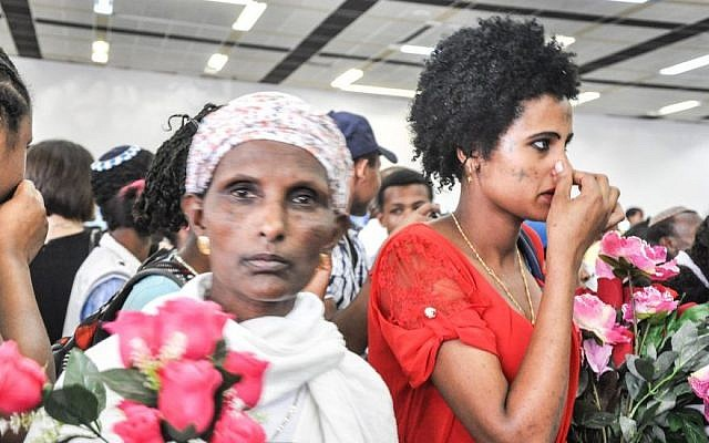 A mother waits for her son to arrive from Gondar on what Israel called the last flight of Falash Mura to the country in 2013 (photo credit: Michal Shmulovich/ToI)