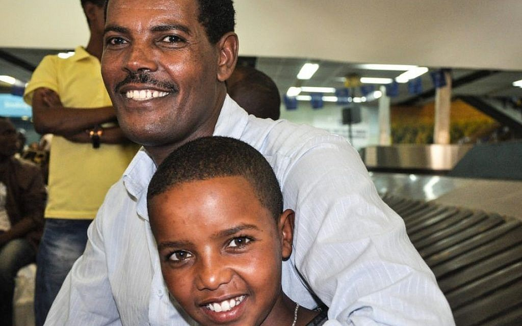 Solomon Mogose and his 14-year-old nephew, who just arrived from Gondar, at Ben Gurion airport Wednesday (photo credit: Michal Shmulovich/ToI)