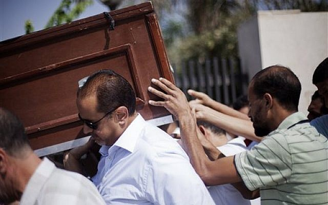 Friends and relatives of Ammar Badie, 38, killed Friday by Egyptian security forces during clashes in Ramses Square, and also son of Muslim Brotherhood's spiritual leader Mohammed Badie, carry his coffin during his funeral in al-Hamed mosque in Cairo's Katameya district, Egypt, Sunday, Aug. 18, 2013 (photo credit: AP/Manu Brabo)