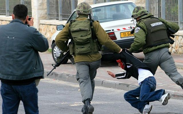Border policemen detain a Palestinian during clashes in Jerusalem (illustrative photo credit: Olivier Fitoussi/Flash90)
