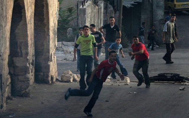 Palestinian youths riot in the West Bank (illustrative photo: Wagdi Ashtiyeh/Flash90)