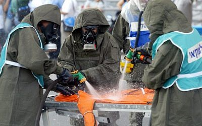 Illustrative photo of Israeli security personnel in chemical protection suits training during a chemical attack exercise in 2007. (photo credit: Roni Schutzer/Flash90)