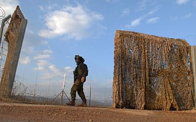 A soldier at the border fence between Israel and Lebanon (photo credit: Hamad Almakt/Flash 90)