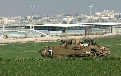 An IDF armored vehicle near the Gaza Strip. (photo credit: Kobi Gideon/Flash90)