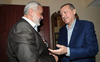 Turkish Prime Minister Recep Tayyip Erdogan speaks with Hamas leader Ismail Haniyeh during a January 2012 meeting in Istanbul. (Mohammed al-Ostaz/ Flash 90)