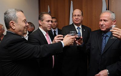 Gilad Erdan, in a pink tie, upon taking office. Far right is the outgoing minister, Avi Dichter, along with Defense Minister Moshe Ya'alon, blue tie, and Ehud Barak (photo credit: Defense Ministry/Flash 90)