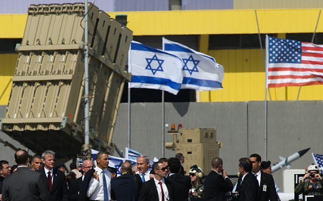 US President Barack Obama and Prime Minister Benjamin Netanyahu alongside an Iron Dome battery during Obama's visit to Israel, March 2013. (photo credit: Nati Shohat/Flash90)