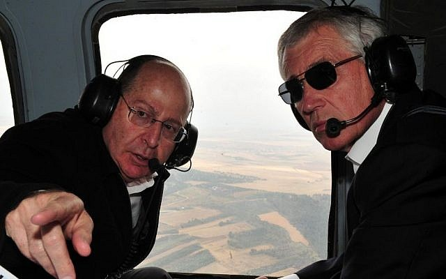 Defense Minister Moshe Ya'alon, left, points during a helicopter tour of the Golan Heights with US Defense Secretary Chuck Hagel, April 2013 (photo credit: Ariel Hermoni/Ministry of Defense/Flash90)