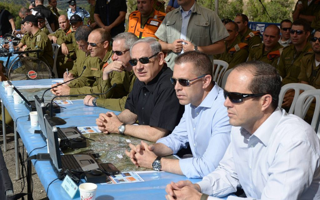 File: Prime Minister Benjamin Netanyahu, in the middle in black, flanked by then-home front defense Minister Gilad Erdan, in blue, and then-IDF Chief of Staff Lt. Gen. Benny Gantz and Maj. Gen. Eyal Eisenberg in May 2013. (Amos Ben Gershom/GPO/Flash90)