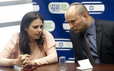MK Ayelet Shaked, left, seen with Jewish Home chairman Naftali Bennett during a party meeting at the the Israeli parliament on June 17, 2013. (photo credit: Flash90)