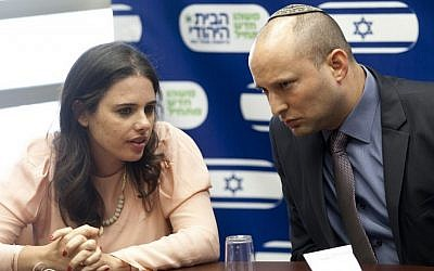MK Ayelet Shaked, left, seen with Jewish Home chairman Naftali Bennett during a party meeting at the the Knesset on June 17, 2013. (photo credit: Flash90)