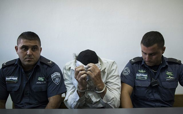 An ultra-Orthodox Jewish man of the anti-Zionist Neturei Karta group, who was charged trying to spy for Iran, seen at the Jerusalem District Court in Jerusalem, August 5, 2013. (photo credit: Yonatan Sindel/Flash90)