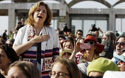 """Chairwoman of the """"Women of the Wall"""" Anat Hoffman wears a prayer shawl as she prays along other members of """"WOW"""" at the Western Wall, in Jerusalem on July 08, 2013. (photo credit: Miriam Alster/Flash90)"""