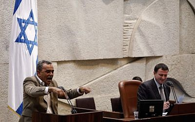 Balad Member of Knesset Jamal Zahalke gesticulates while addressing the Knesset plenum  in Jerusalem, July 31, 2013. (Credit: Flash90)