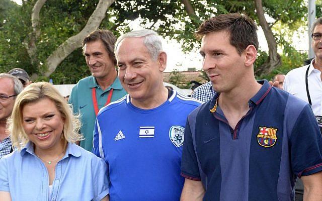 Prime Minister Benjamin Netanyahu and his wife, Sara, walk alongside FC Barcelona superstar Lionel Messi, Sunday, August 4, 2013 (photo credit: Avi Ohayon/GPO/Flash90)