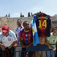 Fans of FC Barcelona football team at the Western Wall in Jerusalem's Old City,  August 04, 2013. (photo credit: Alex Kolomoisky/FLASH90)