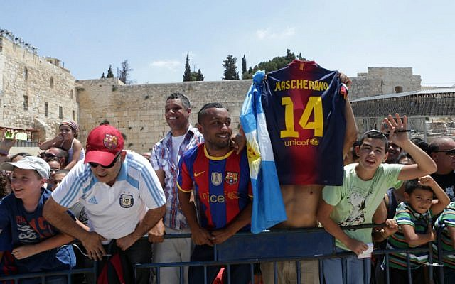 Fans of FC Barcelona football team at the Western Wall in Jerusalem's Old City,  August 04, 2013. (photo credit: Alex Kolomoisky/FLASH90)