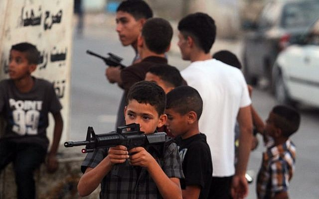 An illustrative photo of Palestinian boys playing with toy guns (photo credit: Issam Rimawi/Flash90)s