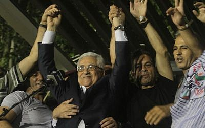 Mahmoud Abbas celebrates the release of Palestinian prisoners as part of Israeli-Palestinian peace negotiations in August 2013. (Issam Rimawi/Flash90)
