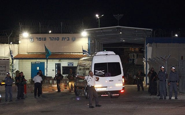 A bus with 12 Palestinian prisoners arriving at Ofer Prison Tuesday night. (photo credit: Flash90)